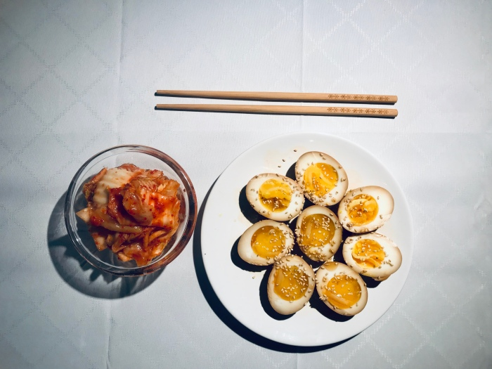 Soy sauce marinaded eggs served with kimchi